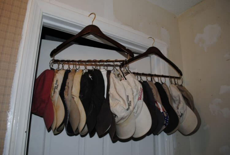 'Hat organizer ideas' from the web at 'https://theskunkpot.com/wp-content/uploads/2017/05/Hat-rack-ideas-with-hanger-via-idolza-com.jpg'