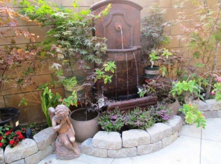 21 Backyard Wall Fountain Ideas to Wow Your Visitors 11